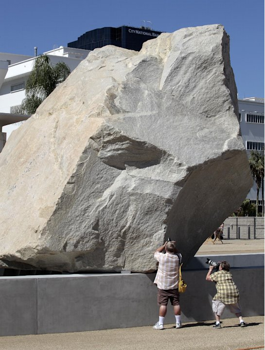 "Visitors take photos of Michael Heizer's ""Levitated Mass""  at the Los Angeles County Museum of Art in Los Angeles, on Sunday June 24,2012.  Thousands showed up as the gigantic work was unveiled on the"