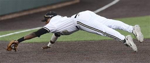Vanderbilt third baseman Xavier Turner dives to stop a ground ball by a Georgia Tech batter, who was out in the fourth inning of an NCAA college baseball tournament regional game Monday, June 3, 2013, in Nashville, Tenn