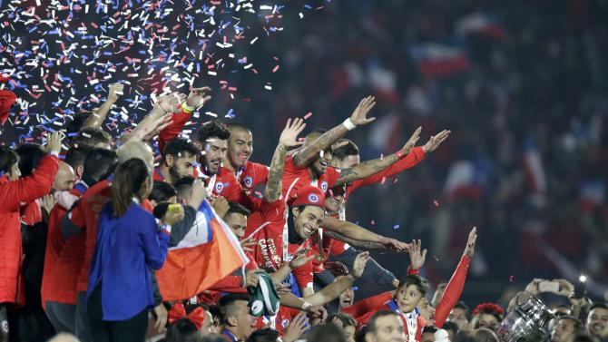 Chile players celebrate during the medal presentation ceremony after they defeated Argentina in the Copa America 2015 final soccer match at the National Stadium in Santiago