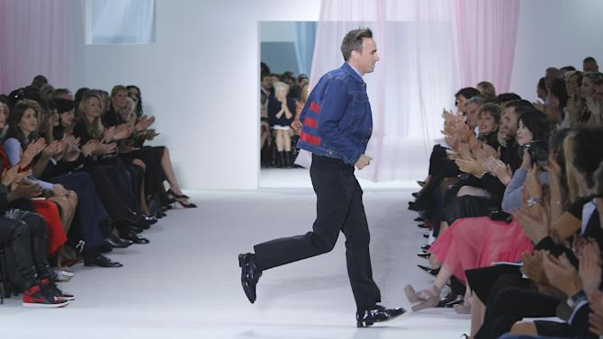FILE - This Sept. 28, 2012 file photo shows Belgian fashion designer Raf Simons at the end of his Dior ready to wear Spring-Summer 2013 collection in Paris, Friday. Simons is the Creative Director at Christian Dior. (AP Photo/Jacques Brinon)