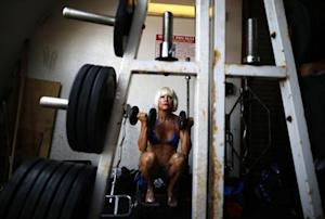 A woman warms up at the Muscle Beach Independence Day bodybuilding contest on Venice Beach in Los Angeles, California, July 4, 2013. REUTERS/Lucy Nicholson/Files