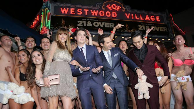 "Sarah Wright, Miles Teller, Skylar Astin and Justin Chon at the LA premiere of ""21 and Over"" at the Westwood Village Theatre on Thursday, Feb. 21, 2013 in Los Angeles. (Photo by Eric Charbonneau/Invision/AP)"