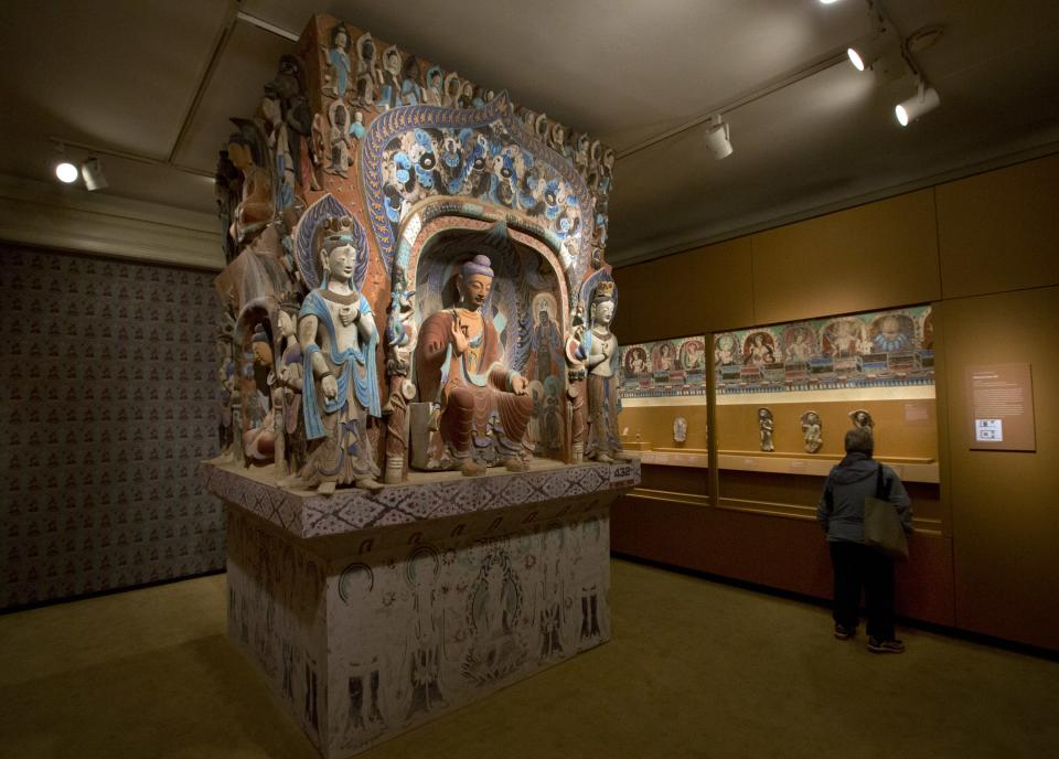 "The central pillar of Mogao Cave 432, from the Western Wei Dynasty, 535-556 AD, is presented in ""Dunhuang: Buddhist Art at the Gateway of the Silk Road,"" at the China Institute, in New York,  Tuesday, April 24, 2013. (AP Photo/Richard Drew)"