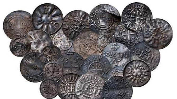 In this undated image made available on Thursday May 16, 2013 show coins from   Bohemia, Germany, Denmark and England discovered during an archaeological dig last year   Danish museum officials said Thursday May 16, 2013 that an archaeological dig last year has revealed 365 items from the Viking era, including 60 rare coins. Danish National Museum spokesman Jens Christian Moesgaard says the coins have a distinctive cross motif attributed to Norse King Harald Bluetooth, who is believed to have brought Christianity to Norway and Denmark. (AP Photo/Polfoto/Stokke Brothers) ONLY EDITORIAL USE DENMARK OUT