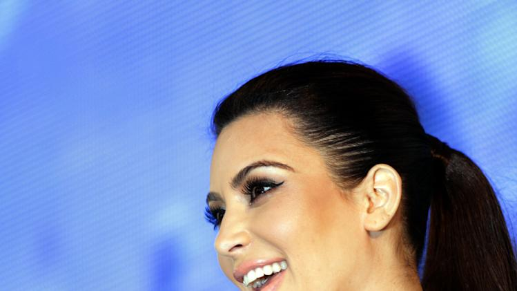 TV star Kim Kardashian, speaks to fans in Riffa, Bahrain, Dec. 1, 2012. Just hours after reality TV star Kim Kardashian gushed about her impressions of Bahrain, riot police fired tear gas to disperse more than 50 hardline Islamic protesters denouncing her presence in the Gulf kingdom. (AP Photo/Hasan Jamali)