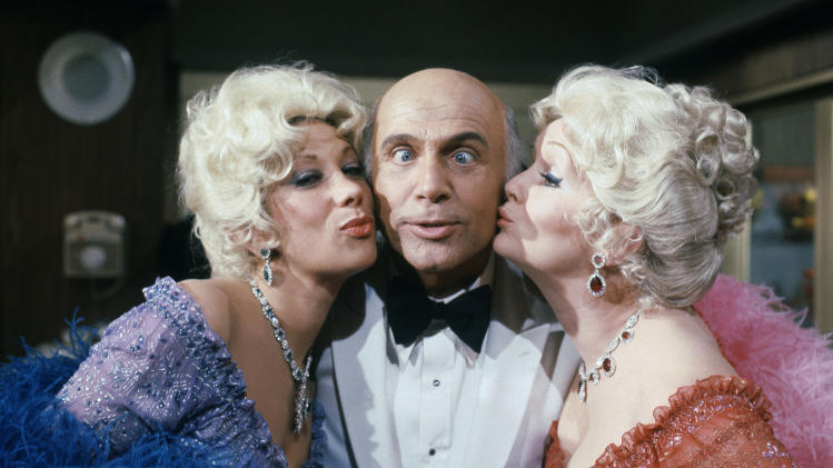 "FILE - This Oct. 15, 1982 file photo shows Gavin MacLeod, center, with actress Debbie Reynolds, right, and Marilyn Michaels as special guest stars on ABC's ""Love Boat."" Debbie Reynolds and Marilyn Michaels are dressed impersonating Zsa Zsa Gabor. (AP Photo/Doug Pizac, File)"