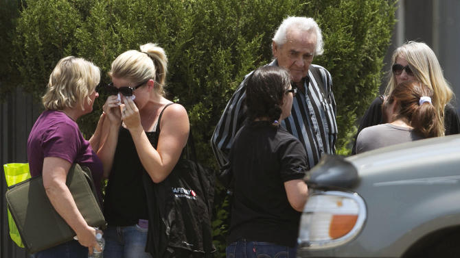 Families gather at the fire station Monday, July 1, 2013, in Prescott, Ariz., where an elite team of firefighters was based. Nineteen of the 20 members of the team were killed Sunday when a wildfire suddenly swept toward them in Yarnell, Ariz. (AP Photo/The Arizona Republic, Patrick Breen)