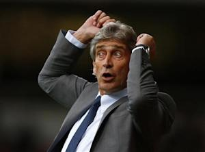 Manchester City's manager Pellegrini reacts during their English Premier League soccer match against West Ham United at the Boleyn Ground in London