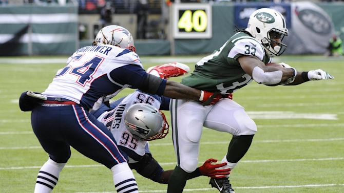 New York Jets running back Chris Ivory (33) breaks a tackle by New England Patriots' Chandler Jones (95) and Dont'a Hightower (54) during the first half of an NFL football game Sunday, Dec. 21, 2014, in East Rutherford, N.J. (AP Photo/Bill Kostroun)