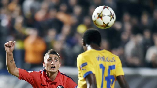 Paris Saint Germain's Verratti fights for the ball with APOEL Nicosia's Vinicius during their Champions League Group F soccer match at GSP Stadium in Nicosia
