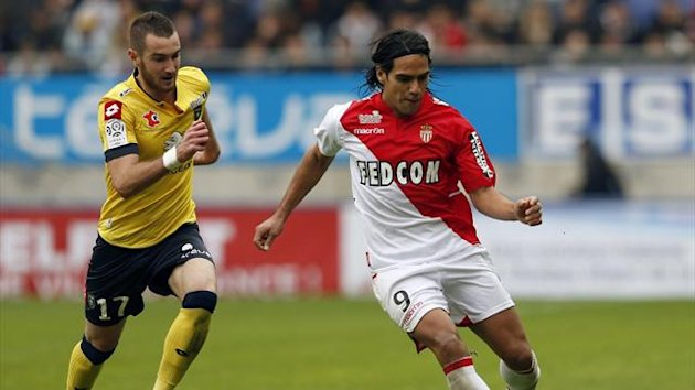 FC Sochaux's Mathieu Peybernes (L) challenges AS Monaco's Radamel Garcia Falcao during their French Ligue 1 match at the Auguste Bonal Stadium in Sochaux (Reuters)