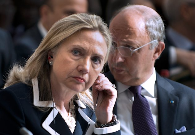 "US Secretary of State Hillary Rodham Clinton and French Foreign Minister Laurent Fabius at the ""Friends of Syria"" conference in Paris, Friday, July 6, 2012. Syrian opposition leaders are pressing diplomats at an international conference for a no-fly zone over Syria, but the U.S. and its European and Arab partners are expected to focus on economic sanctions instead. (AP Photo/Brendan Smialowski, Pool)"
