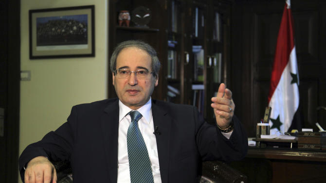 """Deputy Syrian Foreign Minister Faisal Mekdad speaks during an interview with The Associated Press in Damascus, Syria, June 20, 2013. Syria's deputy foreign minister says he has """"every confidence"""" that the Syrian military can recover all of the country's territory now in rebel hands. Mekdad's comments on Thursday came amid a government offensive to recapture areas in the country's central and northern provinces and around the capital, Damascus. (AP Photo)"""