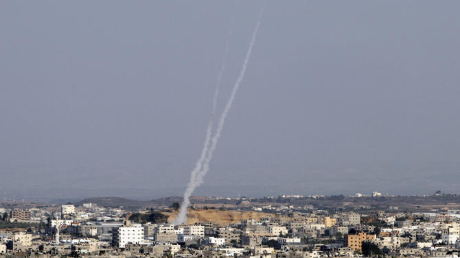 Smoke trails are seen after missiles were fired by Palestinian militants from Gaza City towards southern Israel, Thursday, Nov. 15, 2012.  Militants in the Gaza Strip pounded southern Israel with rocket fire on Thursday, killing three people as the Israeli military pressed forward with a second day of intense air raids and naval attacks on militant targets. (AP Photo/Hatem Moussa)
