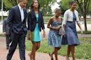 President Barack Obama, left, with first lady Michelle Obama, right, and their daughters Sasha and Malia, second from left, walk from the White House in Washington to attend a Sunday services at a nearby church, Sunday, Aug. 19, 2012. (AP Photo/Manuel Balce Ceneta)