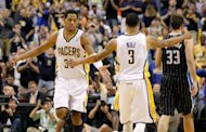 Indiana Pacers' Danny Granger (L) and teammate George Hill (C) during game five of the NBA Eastern Conference series on May 8. The Pacers punched their ticket to the second round of the NBA playoffs by beating Orlando Magic 105-87