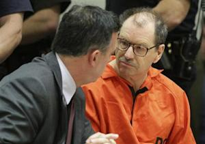 Gary Leon Ridgway speaks to his attorney Mark Prothero in court at the Maleng Regional Justice Center in Kent