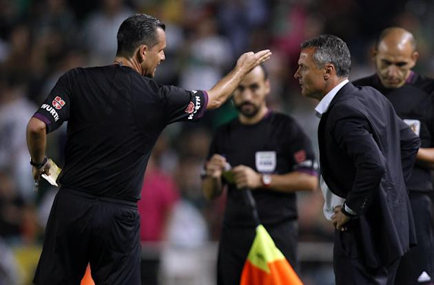 Elche's coach Francisco Escriba Segura receives a red card by referee  Muniz Fernandez during their La Liga soccer match at the Martinez Valero stadium in Elche, Spain, Wednesday, Sept. 25, 2013