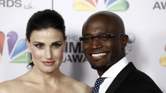 """FILE - In this Feb. 17, 2012 file photo, married actors Idina Menzel, left, and Taye Diggs arrive at the 43rd NAACP Image Awards in Los Angeles. Diggs and Menzel met while in """"Rent"""" off-Broadway and married in 2003 after dating for seven years. The pair once again co-starred on Broadway in the show """"Wild Party"""" in 2000 and on the TV show """"Private Practice."""" (AP Photo/Matt Sayles, File)"""