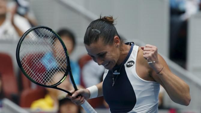 Flavia Pennetta of Italy reacts after winning against Han Xinyun of China during their women's singles match at the China Open tennis tournament in Beijing