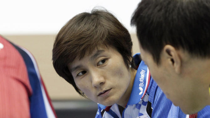 "In this Wednesday, June 27, 2012 photo, Hyun Jung-hwa, the head coach of South Korea's Olympic women table tennis team, left, talks with Yoo Nam-kyu, Olympic men's table tennis team player, at the National Training Center in Seoul, South Korea. South Korean table tennis star Hyun teamed up with North Korean Li Pun Hui in 1991 as part of the first ""unified Korea"" team to march into international competition wearing the flag of the Korean Peninsula. (AP Photo/Ahn Young-joon)"
