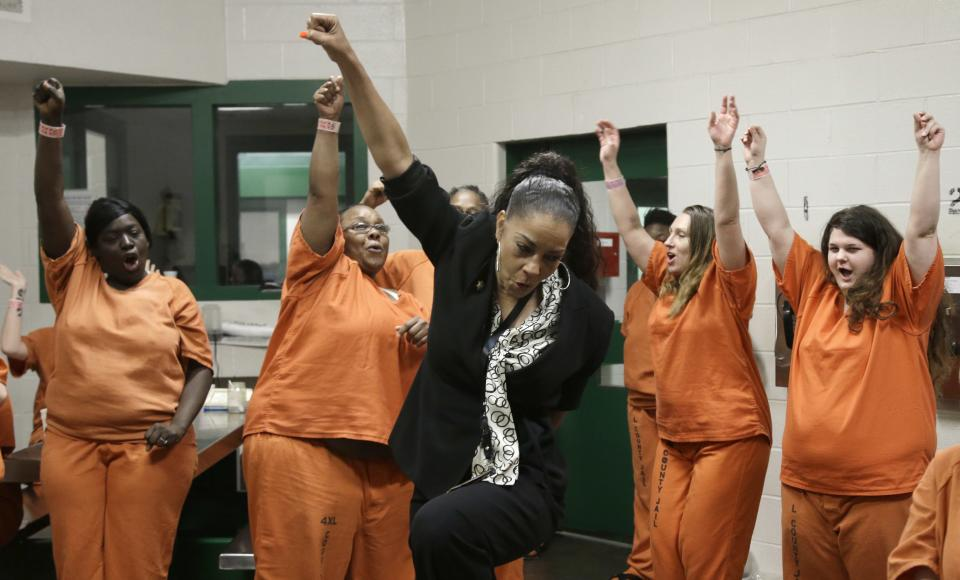 "Kathryn Griffin Grinan, center, and ""her girls"" dance during their meeting in a Harris County cell Tuesday, June 4, 2013, in Houston. Griffin founded and leads the prostitution rehabilitation program We've Been There Done That. (AP Photo/Pat Sullivan)"