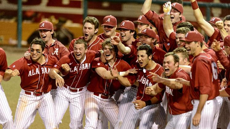 Alabama teammates run to home plate to greet Mikey White after his game-winning home run during an NCAA college baseball game against Kentucky, the second of a doubleheader, Saturday, March 15, 2014, in Tuscaloosa, Ala