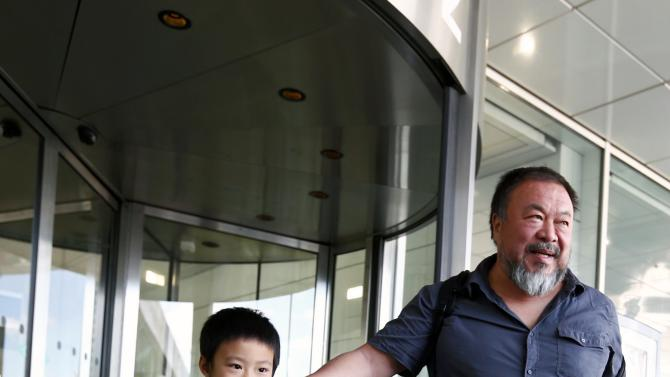 Dissident Chinese artist Ai Weiwei and son Ai Lao leave the airport in Munich