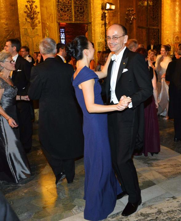 Germany's Thomas Sudhof, who won the 2013 Nobel Prize for medicine or physiology, and his wife Lu Chen dance during the traditional Nobel Prize gala banquet at Stockholm City Hall