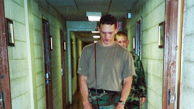 In this July 2000 image provided by Sean McGuire, Israel Keyes is seen buffing a floor during his military days in Fort Lewis, Wash.  Keyes showed no remorse as he detailed how he'd abducted and killed the 18-year-old woman, then demanded ransom, pretending she was alive. His confession cracked the case, but prosecutors questioning him soon realized there was more, he has killed before.  Before divulging more details, Keyes committed suicide in his cell.  (AP Photo/Sean McGuire)
