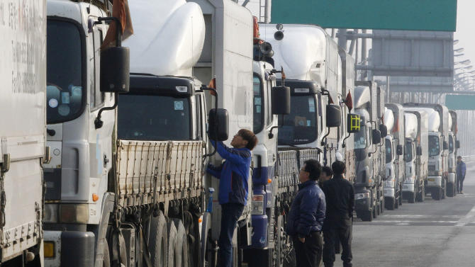 South Korean truck drivers wait to head for the North Korea's city of Kaesong, at the customs, immigration and quarantine office in Paju, South Korea, near the border village of Panmunjom, Thursday, April 4, 2013. North Korea on Wednesday barred South Korean workers from entering a jointly run factory park just over the heavily armed border in the North, officials in Seoul said, a day after Pyongyang announced it would restart its long-shuttered plutonium reactor and increase production of nuclear weapons material. (AP Photo/Ahn Young-joon)