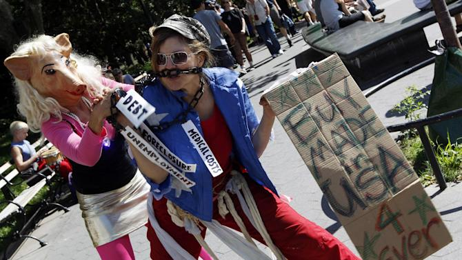 Activist associated with the Occupy Wall Street movement perform a skit during a gathering of the movement in Washington Square park, Saturday, Sept. 15, 2012 in New York. The Occupy Wall Street movement will mark it's first anniversary on Monday.  (AP Photo/Mary Altaffer)