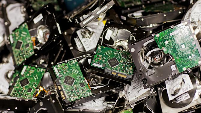 This undated photo made available by Google shows failed drives that are destroyed at a data center in St. Ghislain, Belgium. Google says it destroys malfunctioning storage drives on site to protect user data. (AP Photo/Google, Connie Zhou)