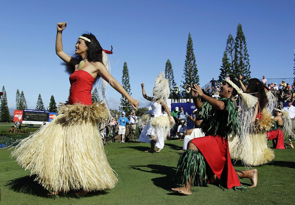 Dancers from the Polynesian Cultural Center perform on the first tee during the opening ceremonies of the Tournament of Champions PGA Tour golf tournament in Kapalua, Hawaii, Friday, Jan. 6, 2012. (AP Photo/Eric Risberg)