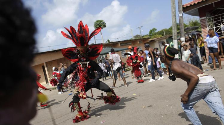 A man dressed up as the devil 'tortures' a participant during the Congos and Devils celebration in Nombre de Dios