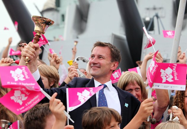 In this photo provided by LOCOG, Jeremy Hunt, Secretary of State for Culture, Olympics, Media and Sport, appears during the All the Bells event at HMS Belfast, to celebrate the first day of the London 2012 Olympic and Paralympic Games on Friday July 27, 2012, in London. (AP Photo/LOCOG, Anthony Charlton)
