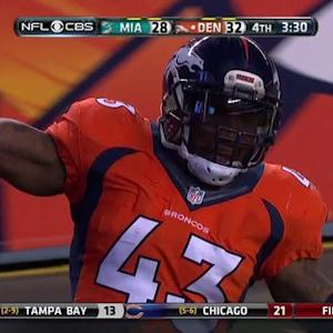 Denver Brocos safety T.J. Ward picks off Tannehill