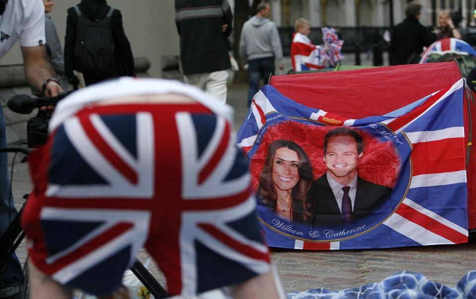 Revelers gather outside Westminster Abbey in London, Tuesday, April 26, 2011.  Revelers are camping out outside Westminster Abbey where Prince William and Kate Middleton are due to get married on Friday, April 29. (AP Photo/Akira Suemori)