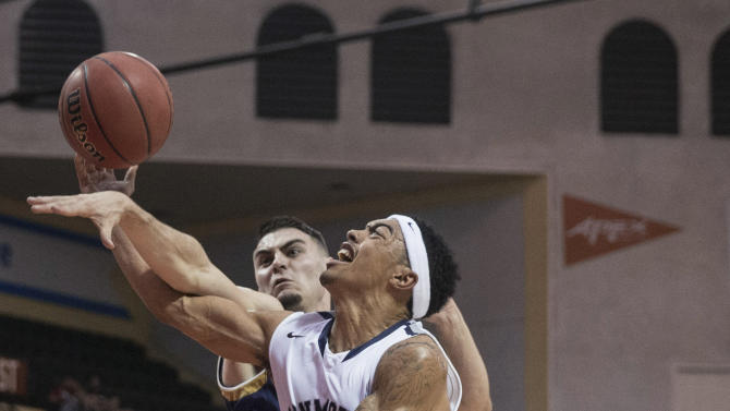 Monmouth guard Justin Robinson (12) is fouled on the way to the basket by Notre Dame guard Matt Farrell during the first half of an NCAA college basketball game Thursday, Nov. 26, 2015, in Orlando, Fla. (AP Photo/Willie J. Allen Jr.)