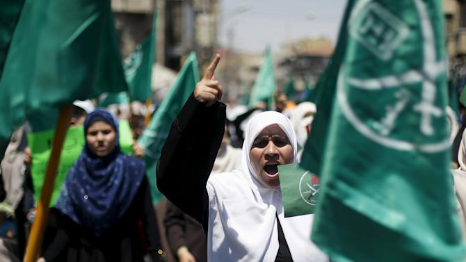 Protesters from the Islamic Action Front shout slogans in Amman