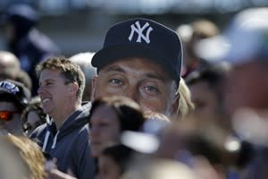 New York Yankees' fans hold up a giant cutout of Derek Jeter's head during a workout at baseball spring training, Monday, Feb. 18, 2013, in Tampa. (AP Photo/Matt Slocum)