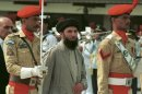 FILE - In this Wednesday, June 26, 1996 file photo, Gulbuddin Hekmatyar, center, passes in front of an honor guard in the Afghan capital of Kabul, Afghanistan, after being sworn in as prime minister, ending four years of bitter fighting among U.S. backed rebels who took control of Kabul from the communist regime. Hekmatyar today is a U.S.-declared terrorist in hiding fighting international forces in Afghanistan. His representatives have opened talks with President Hamid Karzai�s political opponents, as well as Karzai. (AP Photo, File)