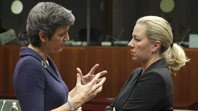 Danish Finance Minister Margrethe Vestager, left, talks with Finnish Finance Minister Jutta Urpilainen, during the EU finance ministers meeting, at the European Council building in Brussels, Tuesday, Dec. 4, 2012. European Union finance ministers will seek to agree Tuesday to the principles of a eurozone banking supervisor, EU diplomats said. Earlier this year, the 27 member states pledged to reach the outlines of an agreement by the end of 2012, allowing the supervisor to come into force during the course of the following year. (AP Photo/Yves Logghe)