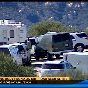 Burning body found on dirt road near Alpine