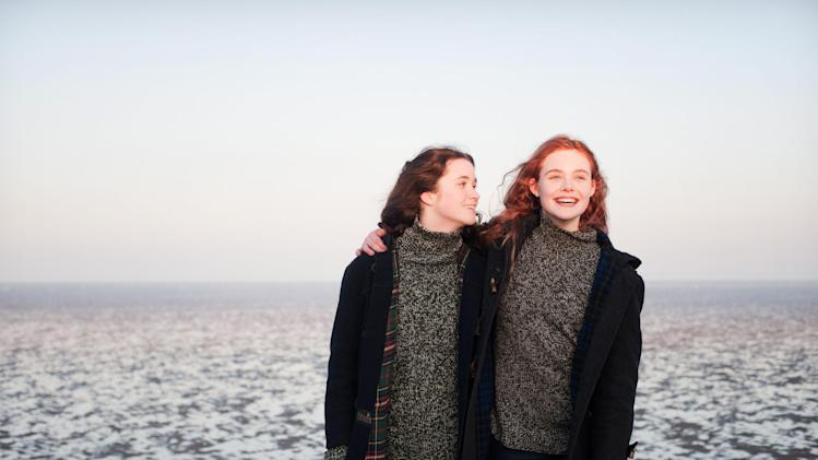 "This publicity photo released by A24 Films shows Alice Englert, left, as Rosa and Elle Fanning as Ginger in a scene from the film, ""Ginger and Rosa,"" directed by Sally Potter.  (AP Photo/A24 Film, Nicola Dove)"