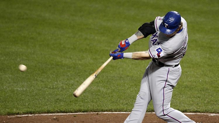 Texas Rangers' Josh Hamilton hits a two-run home run in the eighth inning of a baseball game against the Baltimore Orioles in Baltimore, Tuesday, May 8, 2012. Texas won 10-3. Hamilton had four home runs on the night. (AP Photo/Patrick Semansky)
