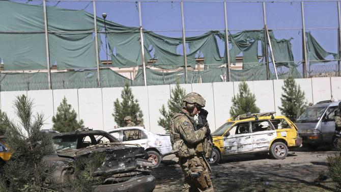 Member of the U.S. troops walks at the site of a suicide attack in Kabul