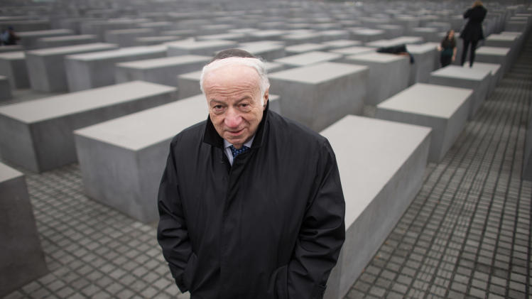 CORRECTS NAME TO BERMAN The Chairman of the Jewish Claims Conference Julius Berman walks through the Holocaust Memorial after an interview with The Associated Press,  in Berlin, Thursday, Nov. 15, 2012. Sixty years after a landmark accord started German government compensation for victims of Nazi crimes, fund administrators and German officials say payments to Holocaust survivors are needed more than ever as they enter their final years. In acknowledgement of that, German Finance Minister Wolfgang Schaeuble was to sign off officially Thursday on revisions to the original 1952 compensation treaty, increasing pensions for those living in eastern Europe and broadening who is eligible for payments.   (AP Photo/Markus Schreiber)