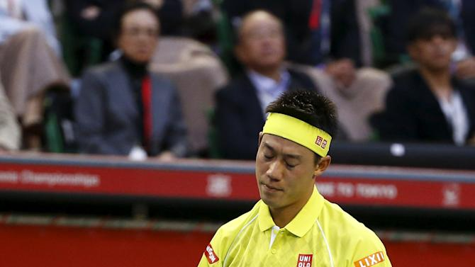 Japan's Kei Nishikori reacts as he plays Benoit Paire of France during their men's singles semifinal match at the Japan Open tennis championships in Tokyo