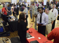 <p> In this photo taken Thursday, May 9, 2013, Jennifer Wilhoit of U. S. Express, left, talks with Devin Washington while others wait in line as 63 companies participate in a job fair at the Brainerd Crossroads in Chattanooga, Tenn. The Labor Department reports on the number of Americans who applied for unemployment benefits last week on Thursday, May 16, 2013. (AP Photo/Chattanooga Times Free Press, John Rawlston) THE DAILY CITIZEN OUT; NOOGA.COM OUT; CLEVELAND DAILY BANNER OUT; LOCAL INTERNET OUT; MANDATORY CREDIT: JOHN RAWLSTON/CHATTANOOGA TIMES FREE PRESS